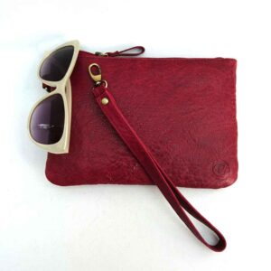 berry leather clutch bag