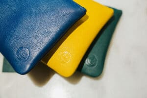leather clutch makeup bags blue mustard yellow and green