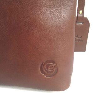 the tan leather county crossbody bag ages beautifully