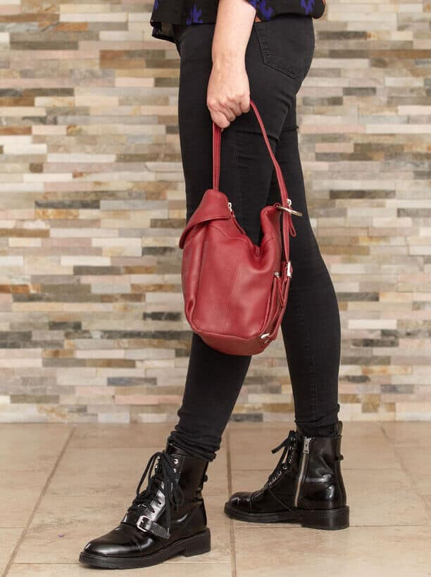 Red leather backpack worn multiple ways